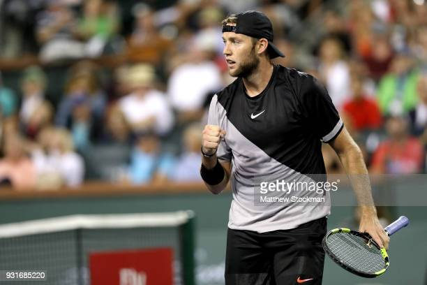 Jack Sock celebrates while playing Feliciano Lopez of Spain during the BNP Paribas Open at the Indian Wells Tennis Garden on March 13 2018 in Indian...