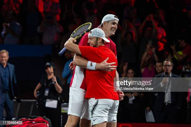 Jack Sock of Team World and John Isner of Team World celebrates their win during Day 3 of the Laver Cup 2019 at Palexpo on September 22, 2019 in...