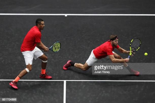 Jack Sock of Team World hits a volley playing with Nick Kyrgios during there doubles match against Tomas Berdych and Rafael Nadal of Team Europe on...