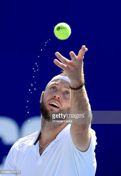Jack Sock of the New York Empire serves against the Philadelphia Freedoms during the semifinals of the World TeamTennis at The Greenbrier on August...