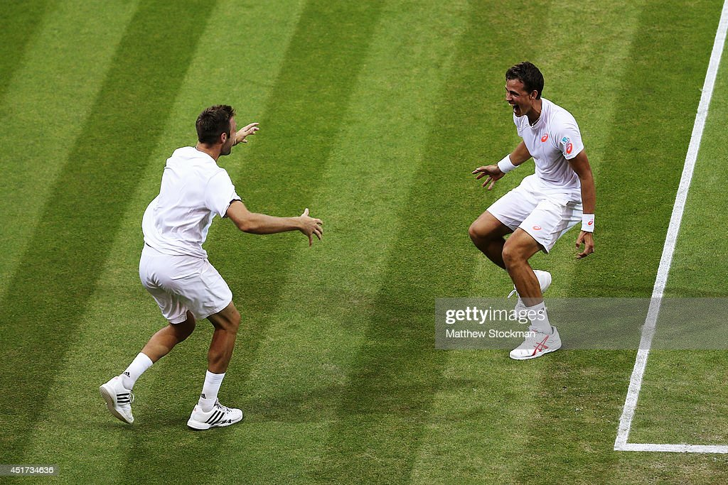 Jack Sock of the United States (l) and Vasek Pospisil of Canada celebrates after winning the Gentlemen's Doubles Final against Bob Bryan and Mike Bryan of the United States on day twelve of the Wimbledon Lawn Tennis Championships at the All England Lawn Tennis and Croquet Club on July 5, 2014 in London, England.
