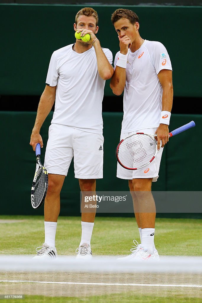 Jack Sock of the United States (l) and Vasek Pospisil of Canada during their Gentlemen's Doubles Final against Bob Bryan and Mike Bryan of the United States on day twelve of the Wimbledon Lawn Tennis Championships at the All England Lawn Tennis and Croquet Club on July 5, 2014 in London, England.