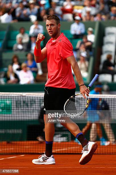 Jack Sock of the United States celebrates a point in his Men's Singles match against Rafael Nadal of Spain on day nine of the 2015 French Open at...