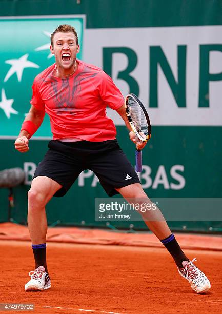 Jack Sock of the United States celebrates match point during his Men's Singles match against Pablo Caerreno Busta of Spain on day five of the 2015...