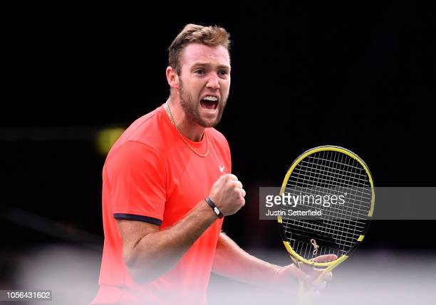 Jack Sock of The United States celebrates winning the first set during his men's singles match against Dominic Thiem of Austria during Day five of...