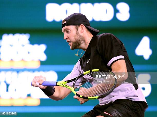 Jack Sock of the United States hits a forehand in his match against Feliciano Lopez of Spain during the BNP Paribas Open at the Indian Wells Tennis...
