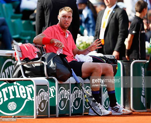 Jack Sock of the United States looks on inbetween play in his Men's Singles match against Rafael Nadal of Spain on day nine of the 2015 French Open...