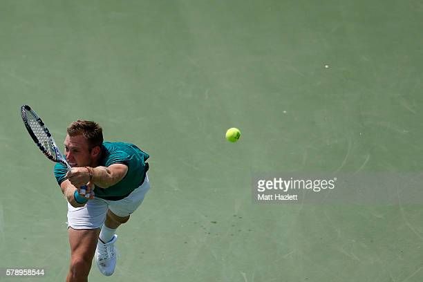 Jack Sock of the United States of America misses a serve from Ivo Karlovic of Croatia during day 5 of the Citi Open at Rock Creek Tennis Center on...