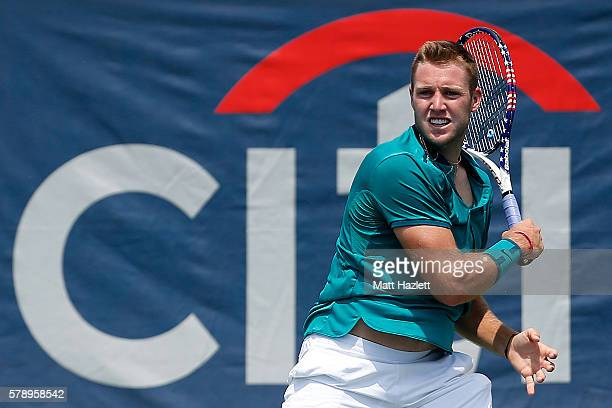 Jack Sock of the United States of America returns a shot to Ivo Karlovic of Croatia during day 5 of the Citi Open at Rock Creek Tennis Center on July...