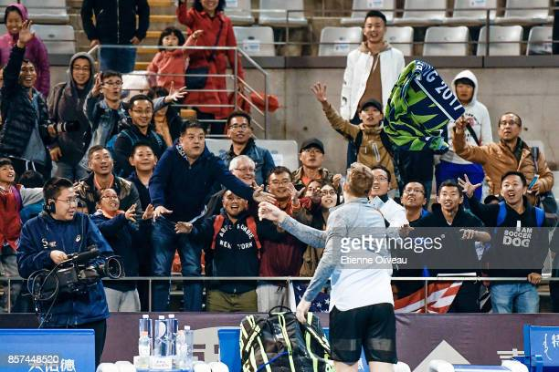 Jack Sock of the United States partner of John Isner of the United States throws his towel to the audience after his MenÕs double first round match...