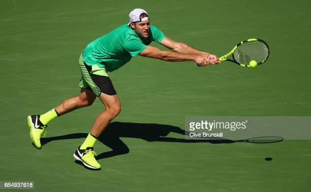 Jack Sock of the United States plays a backhand against Roger Federer of Switzerland in their semi final match during day thirteen of the BNP Paribas...