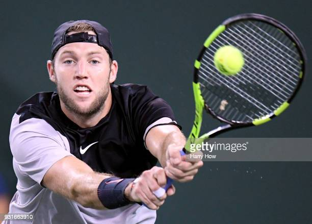 Jack Sock of the United States plays a backhand in his match against Feliciano Lopez of Spain during the BNP Paribas Open at the Indian Wells Tennis...