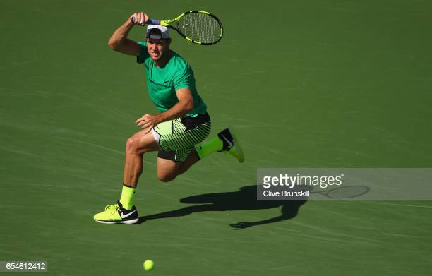 Jack Sock of the United States plays a forehand against Kei Nishikori of Japan in their quarter final match during day twelve of the BNP Paribas Open...