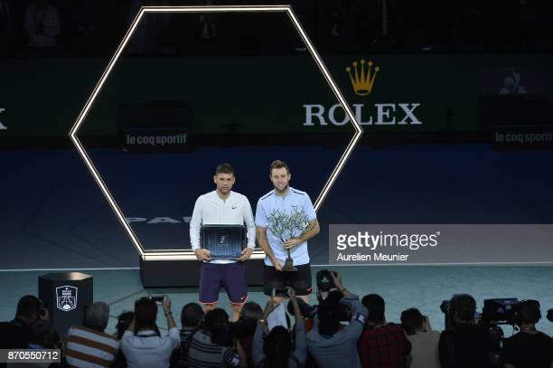 Jack Sock of the United States poses with the trophy next to Filip Krajinovic of Serbia for photographers after winning the men's singles final match...