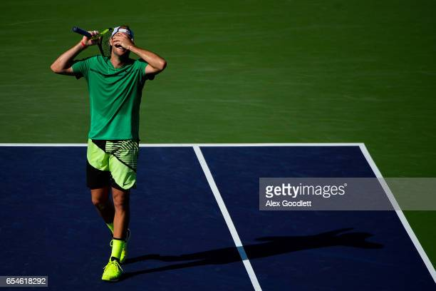 Jack Sock of the United States reacts to a point during a match against Kei Nishikori of Japan in the men's quarterfinals match on Day 12 during the...