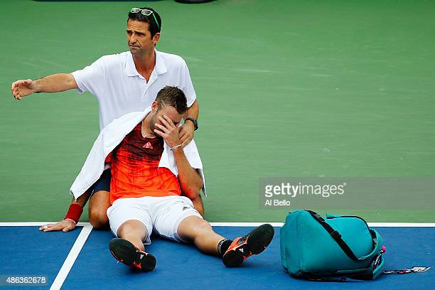 Jack Sock of the United States receives assistance for heat exhaustion during his Men's Singles Second Round match against Ruben Bemelmans of Belgium...