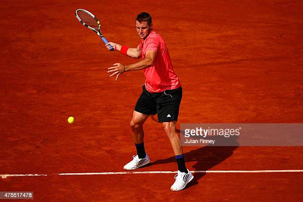 Jack Sock of the United States returns a shot in his Men's Singles match against Rafael Nadal of Spain on day nine of the 2015 French Open at Roland...