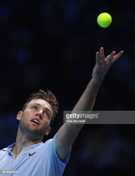 Jack Sock of the United States serves against Roger Federer of Switzerland during the Nitto ATP World Tour Finals at O2 Arena on November 12 2017 in...