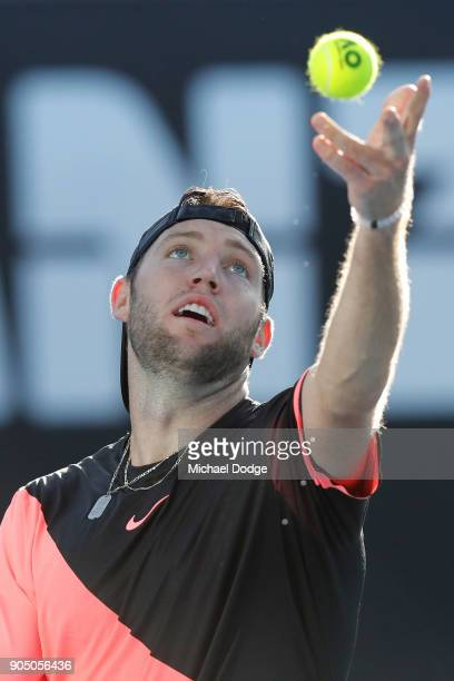 Jack Sock of the United States serves in his first round match against Yuichi Sugita of Japan on day one of the 2018 Australian Open at Melbourne...