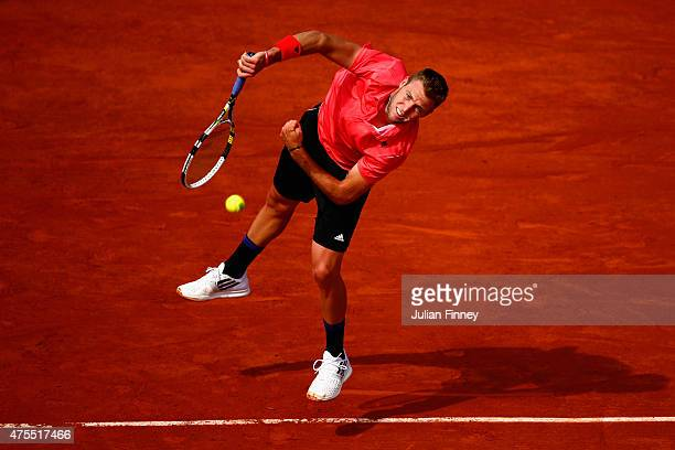 Jack Sock of the United States serves in his Men's Singles match against Rafael Nadal of Spain on day nine of the 2015 French Open at Roland Garros...