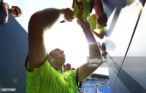Jack Sock of the United States signs autographs for fans after his win over Marin Cilic of Croatia during his third round Men's Singles match on Day...