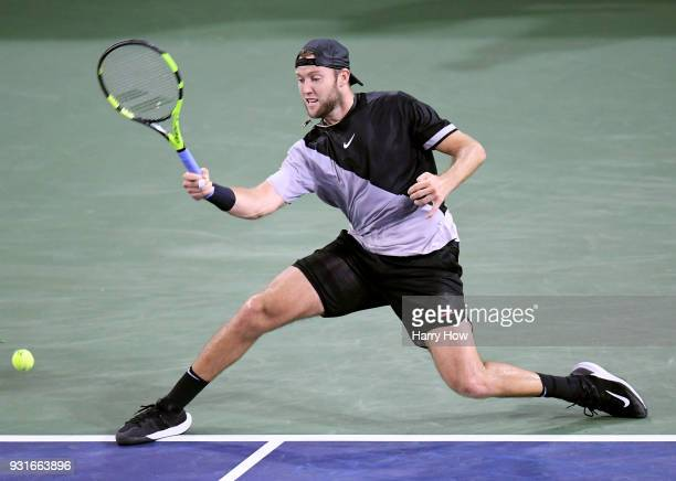 Jack Sock of the United States stretchs for a forehand in his match against Feliciano Lopez of Spain during the BNP Paribas Open at the Indian Wells...