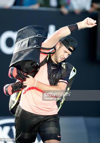 Jack Sock of the United States walks off the court after losing his first round match against Yuichi Sugita of Japan on day one of the 2018...