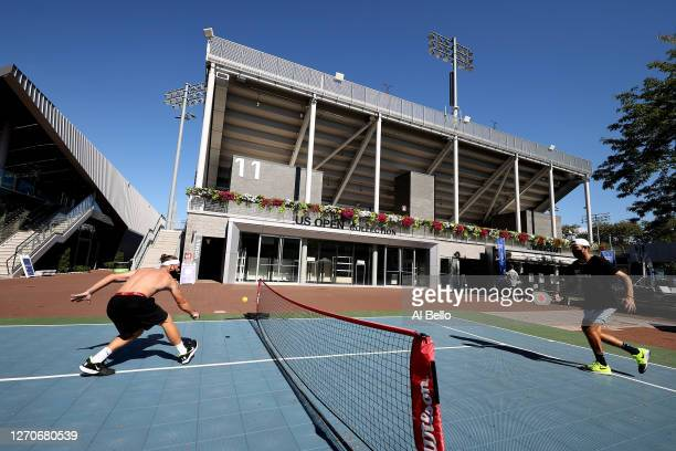 Jack Sock of the United States warms up against his coach Alex Bogomolov in a recreational game of Pickleball outside of Arthur Ashe Stadium on Day...
