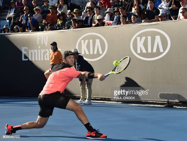 Jack Sock of the US plays a backhand return to Japan's Yuichi Sugata during their men's singles first round match on day one of the Australian Open...