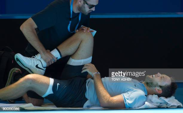 Jack Sock of the US receives medical treatment during his fifth session men's singles match Yuichi Sugita of Japan on day four of the Hopman Cup...