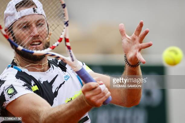 Jack Sock of the US returns the ball to Austria's Dominic Thiem during their men's singles second round tennis match on Day 4 of The Roland Garros...