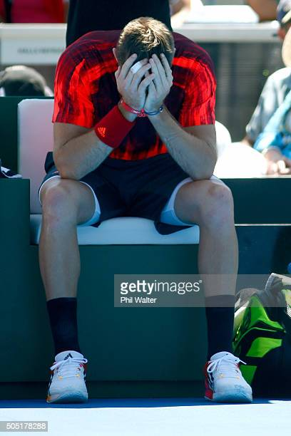 Jack Sock of the USA holds his hands to his head before retiring sick in his singles final against Roberto Bautista Agut of Spain on day six of the...