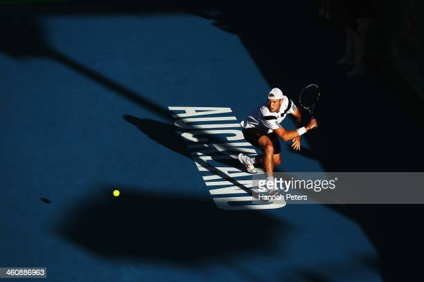 Jack Sock of the USA plays a backhand against Adrian Mannarino of France during day one of the Heineken Open at ASB Tennis Centre on January 6 2014...