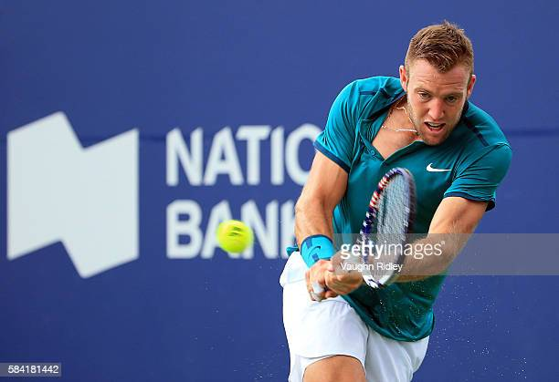 Jack Sock of the USA plays a shot against Stan Wawrinka of Switzerland during Day 4 of the Rogers Cup at the Aviva Centre on July 28 2016 in Toronto...