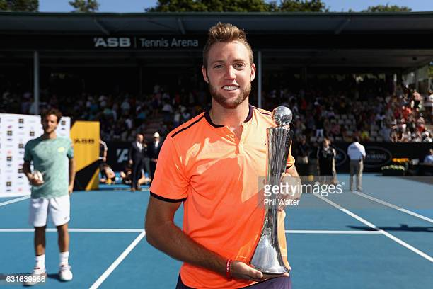 Jack Sock of the USA poses with the trophy following the mens singles final between Jack Sock of the USA and Joao Sousa of Portugal on day 13 of the...