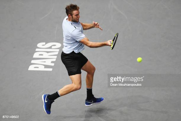 Jack Sock of the USA returns a forehand against Julien Benneteau of France during their semi final on day 6 of the Rolex Paris Masters held at the...