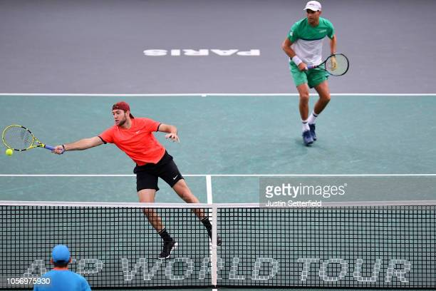 Jack Sock of United States and Mike Bryan of United States in action during there Semi Final match against Horia Tecau of Romania and JeanJulien...