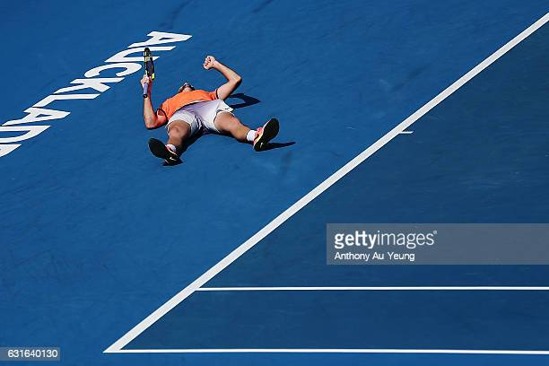 Jack Sock of USA falls to the ground in celebration after winning his singles final match against Joao Sousa of Portugal on day 13 of the ASB Classic...