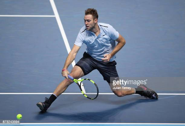Jack Sock of USA in action in his match against Roger Federer of Switzerland during day one of the Nitto ATP World Tour Finals tennis at the O2 Arena...