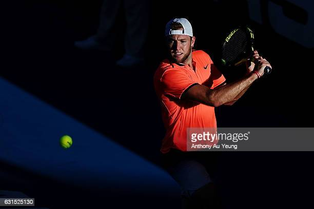 Jack Sock of USA plays a backhand in his match against Jeremy Chardy of France on day 11 of the ASB Classic on January 12, 2017 in Auckland, New...