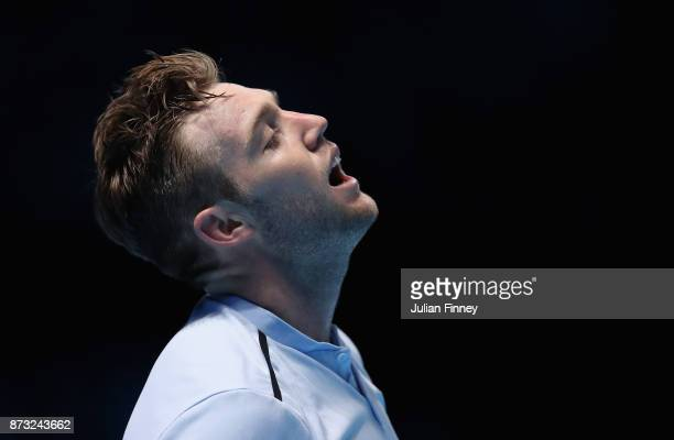 Jack Sock of USA reacts in his match against Roger Federer of Switzerland during day one of the Nitto ATP World Tour Finals tennis at the O2 Arena on...
