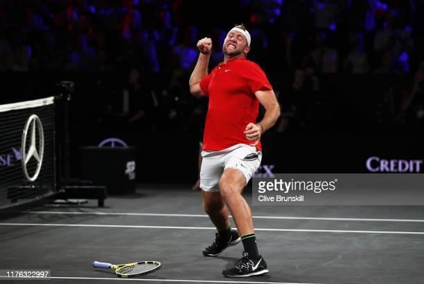 Jack Sock, playing partner of John Isner of Team World celebrates match point in his doubles match against Roger Federer and Stefanos Tsitsipas of...