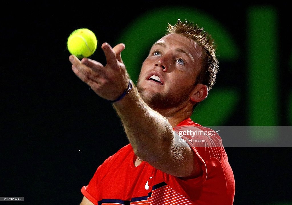 Jack Sock plays a match against Milos Raonic of Canada during Day 8 of the Miami Open presented by Itau at Crandon Park Tennis Center on March 28, 2016 in Key Biscayne, Florida.