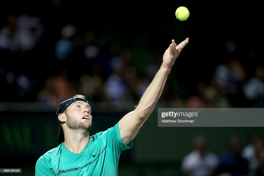 Jack Sock serves to Jiri Vesely of Czech Republic during the Miami Open at the Crandon Park Tennis Center on March 26, 2017 in Key Biscayne, Florida.