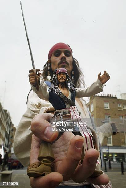 Jack Sparrow lookalike poses with a toy version of the Pirates of Caribbean character at the Dream Toys 2006 exhibition on October 11 2006 in London...