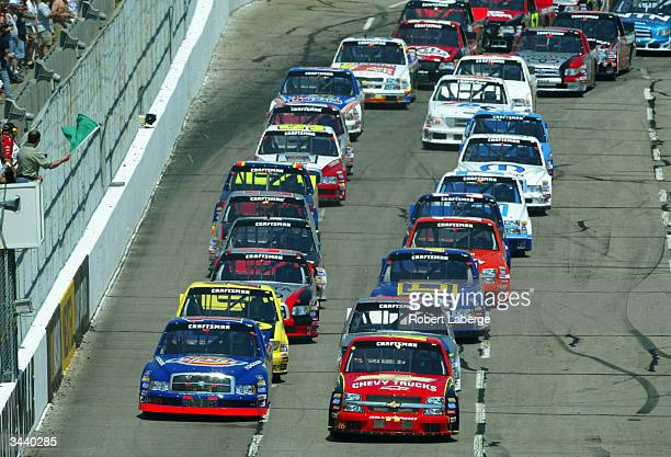 Jack Sprague driver of the Chevy Trucks Chevrolet and Chad Chaffin driver of the Dickies Racing Dodge lead the field at the start of the NASCAR...