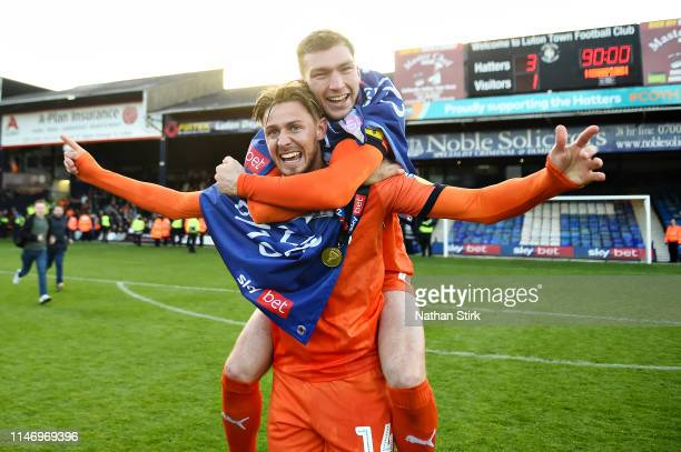 Jack Stacey and teammate Harry Cornick of Luton Town celebrate their side winning the league after the Sky Bet League One match between Luton Town...