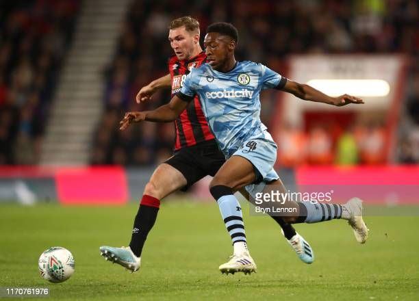 Jack Stacey of AFC Bournemouth battles for possession with Ebrima Adams of Forest Green Rovers during the Carabao Cup Second Round match between AFC...