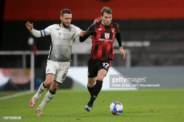 Jack Stacey of Bournemouth sprints clear of Matt Grimes of Swansea City during the Sky Bet Championship match between AFC Bournemouth and Swansea...