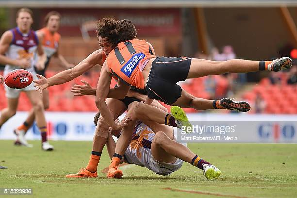Jack Steele collides with Josh Kelly of the Giants as he is tackled during the NAB Challenge AFL match between the Brisbane Lions and the Greater...